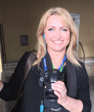 Photo of Rhonda Erb looking radiant in Italy with her camera