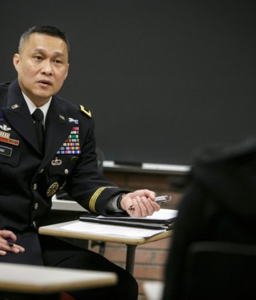 Luong listens to a cadet during his visit with USC ROTC