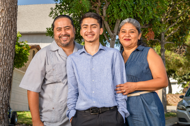 NAI scholar Ivan posing with his family.