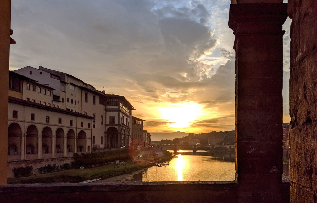 sunset arno river