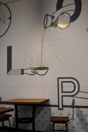 Wall art creates a unique space at this inviting coffee bar.