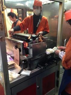 Feeding skewers into roaster
