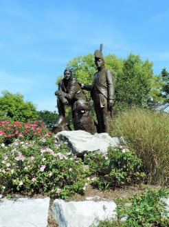 A statue stands as a tribute to the Corps of Discovery, and to Lewis and Clark, in Frontier Park.