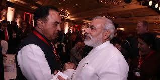 Dr. Swamy with Modi.