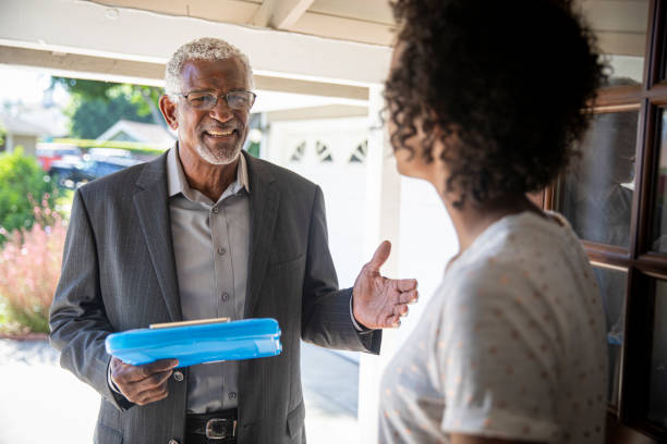 A senior black man visits with a potential voter to earn her support.