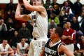 DAVE BAKER Times/Report Badger Lincoln Wieseman goes up for a shot against the Broncos Jan. 18. Wieseman was high scorer with 16 points. Union Grove beat Lake Geneva 56-54.