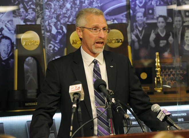 Kevin Bullis, head coach of the University of Wisconsin-Whitewater Warhawks football team shown speaking at a press conference in February when he was hired (above) and coaching (below), said he plans to carry on the winning tradition at UW-Whitewater. His successor, Lance Leipold, is now the head football coach at Buffalo University, a Division 1 college. (Bruce Gidlow and Michael Mcloone photo)