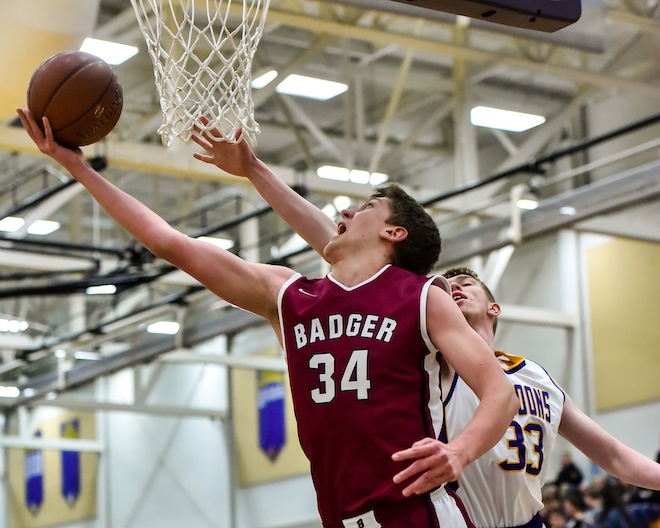 Austin Jackson scores two of his 17 points against Oconomowoc on Friday in the Badger's loss in the opening round of WIAA playoffs. (David Baker photo)