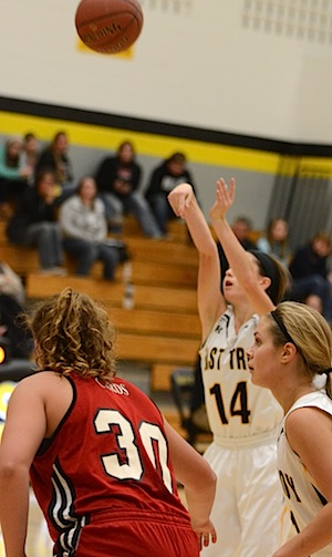 East Troy High School's Mackenzie Lindow (No. 14) shoots a free throw in the Dec. 8 win over Brodhead. Londow iced three of four free throw attempts during the final minute to preserve the Trojan victory. (Eric Kramer photo)