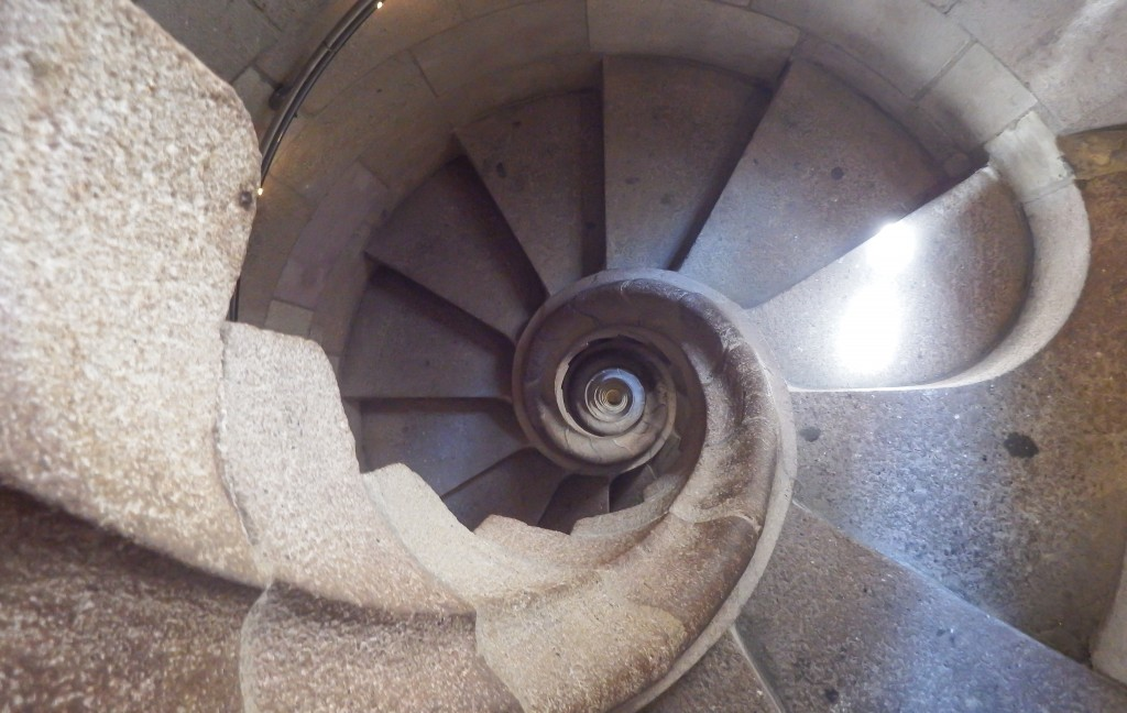 Looking down the nautilus staircase of Sagrada Familia's towers in Barcelona, Spain