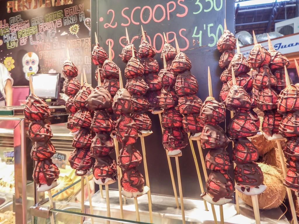 Chocolate covered strawberries at La Boqueria market in Barcelona, Spain