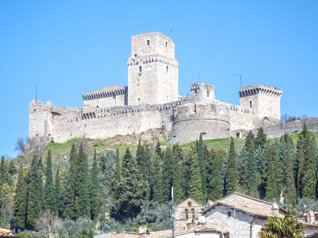 The medieval fortress of Rocca Maggiore high above this small Umbrian town seen during a day trip to Assisi, Italy