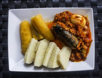 Garden egg stew with boiled yam and plantain