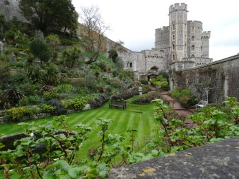 green lawn with pond and some of Windsor Castle