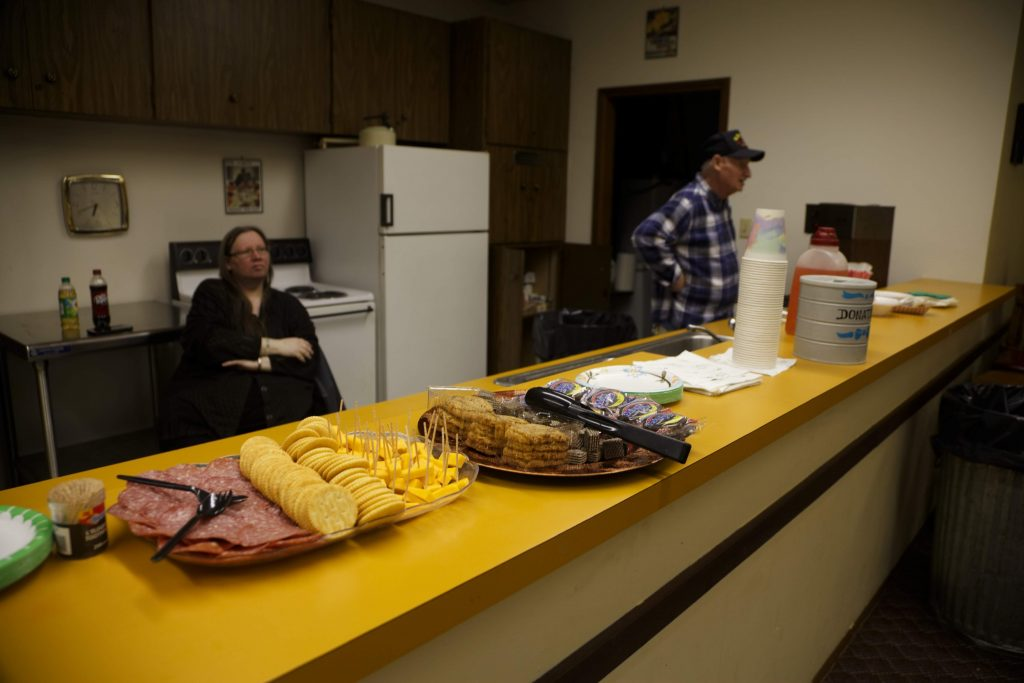 Connie Vitiritti and father, Chuck Vitiritti, offer food and beverages to guests at Skyway VFW Post #9430 on January 15th, 2019 for WHCA's Winter Quarterly Community Meeting.
