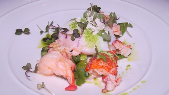 Lobster with freeze dried pea sprouts asparagus and 64 degree egg