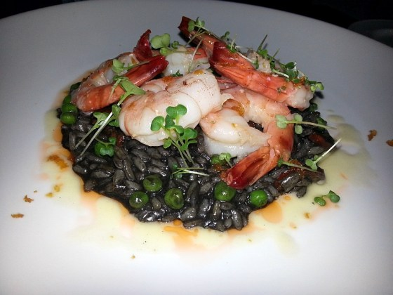 Butter poached prawns with squid ink risotto at Hart House