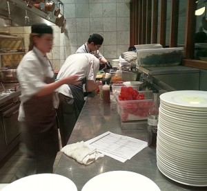 Preparing food at the open kitchen at West