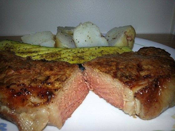 Fuego Diablo steak cooked medium served with baby potatoes and grilled zucchini