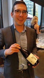 Jason Yamasaki with his jy Pinot Noir Ancient Method sparkling wine