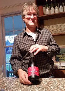 Jim with a bottle of his Allegria Rose Brut sparkling wine