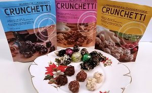 Brockmann's Crunchetti chocolates and selected Truffini on a plate for tasting