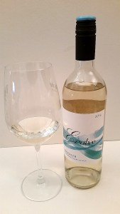 Evolve Cellars Viognier with wine in glass