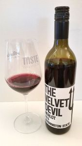 Charles Smith Wines The Velvet Devil Merlot 2015 with wine in glass