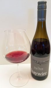 Haywire Free Form Pinot Noir 2015 with wine in glass