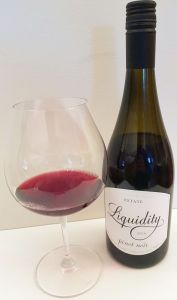 Liquidity Estate Pinot Noir 2016 with wine in glass