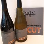 Winemakers CUT bottles of wine