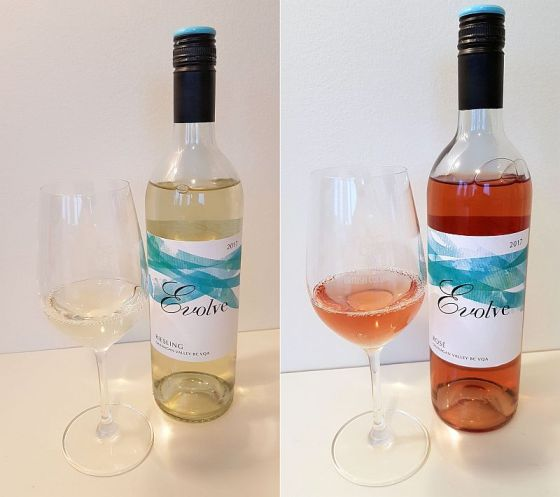 Evolve Cellars Riesling and Rose 2017 with wine in glass