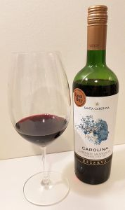 Santa Carolina Cabernet Sauvignon Reserva 2017 with wine in glass