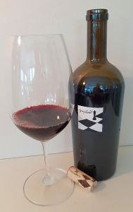 CheckMate Artisinal Winery Opening Gambit Merlot 2014 with wine in glass