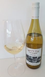 Monte Creek Ranch Chardonnay 2017 with wine in glass
