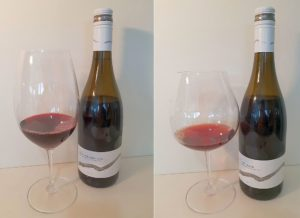 Mt. Boucherie Blaufrankisch and Pinot Noir 2017 with wine in glass