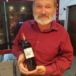 Doug from Sagewood Winery with a bottle of his Marechal Foch 2018