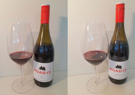 Road 13 Vineyards GSM and Syrah Malbec 2017 with wine in glass