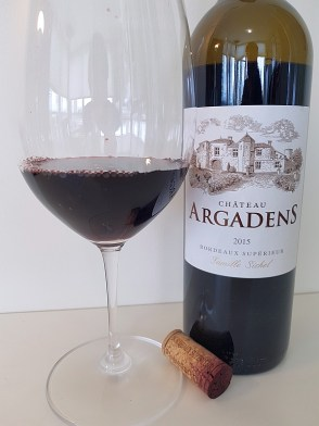 Chateau Argadens Red 2015 with wine in glass