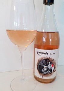 Gratitude by JAK's Rosé 2019 with wine in glass