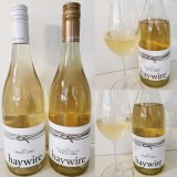 Haywire Pinot Gris 2019 and Haywire Switchback Vineyard Pinot Gris 2018 with wines in glass