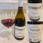 Haywire Pinot Noir 2018 with wine in glass