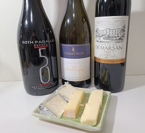 CedarCreek Chardonnay 2017, 50th Parallel Estate Pinot Noir 2017, and Château de Marsan 2010 wines with 3 cheeses
