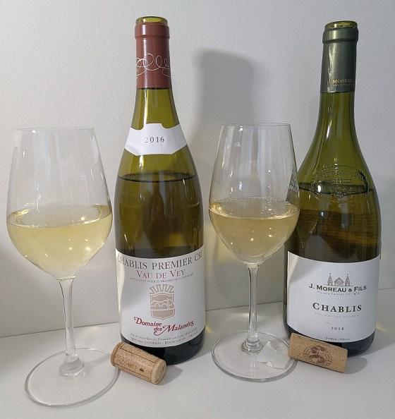 J. Moreau & Fils Chablis 2018 and Domaine des Malandes Chablis Premier Cru, Vau de Vey, 2016 with wines in glasses