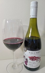 Yalumba Organic Shiraz 2019 with wine in glass