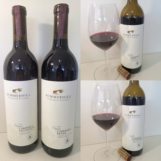 Summerhill Pyramid Winery Organic Cabernet Franc 2018 and Cabernet Sauvignon 2019 with wines in glasses