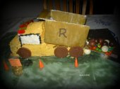This cake is made out of pound cake, candies, cardboard and chocolate candies.