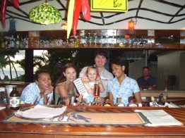 Never too young to have your photo taken behind the bar at Denarau