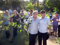 Muriel Cook (L) sponsored a $30 Swamp Mahogony Tree pictured with Suzy Berry Resort Manager.