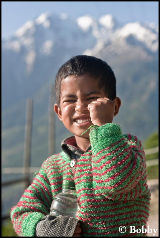 Local kid, enjoying and posing!